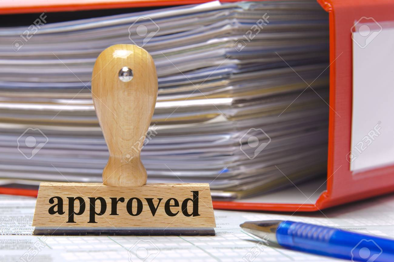 rubber stamp in office marked with approved Stock Photo - 15542285