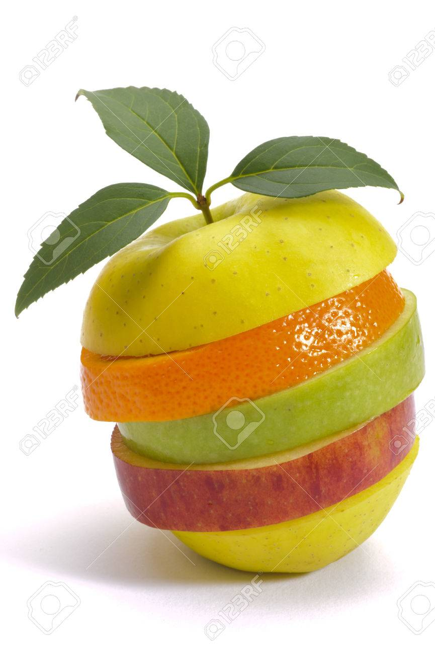 stack of sliced fresh mixed fruits over white - 25110992
