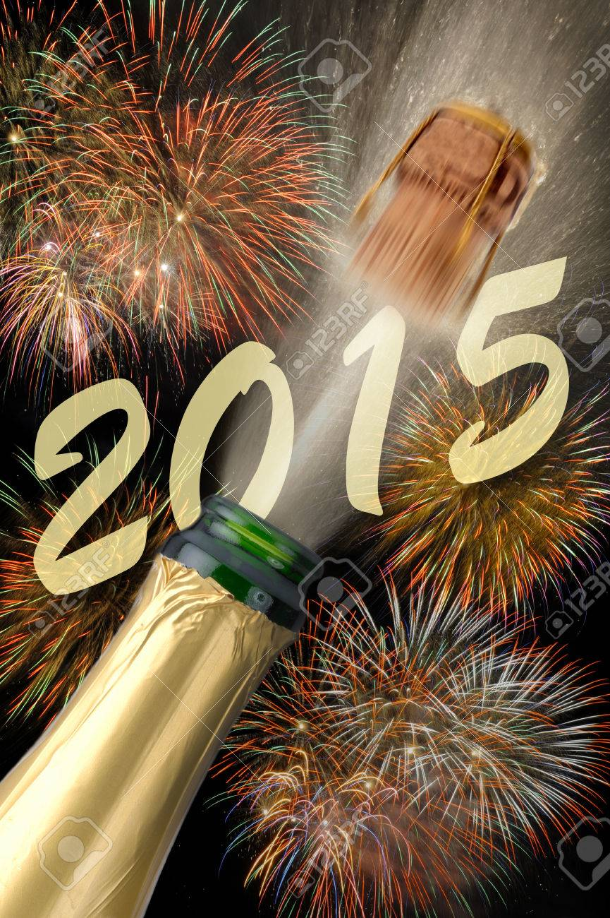 popping champagne with firework for new year 2015 - 31428639