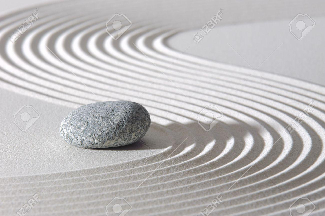 Japanese ZEN garden with stone in sand - 32640497
