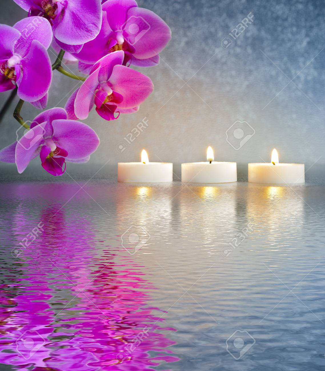 Japanese ZEN Garden With Candle Lights Mirroring In Water Stock Photo
