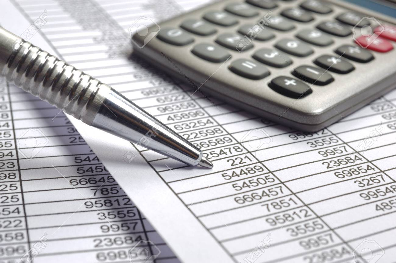 financial budget calculation with summary tables and pen stock photo