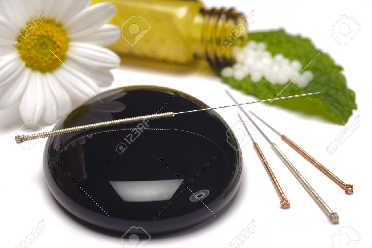 alternative medicine with herbal pills and acupuncture - 37168309