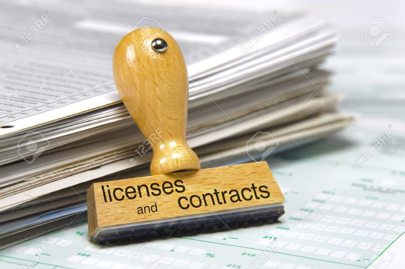 licenses and contracts printed on rubber stamp over documents - 37208036