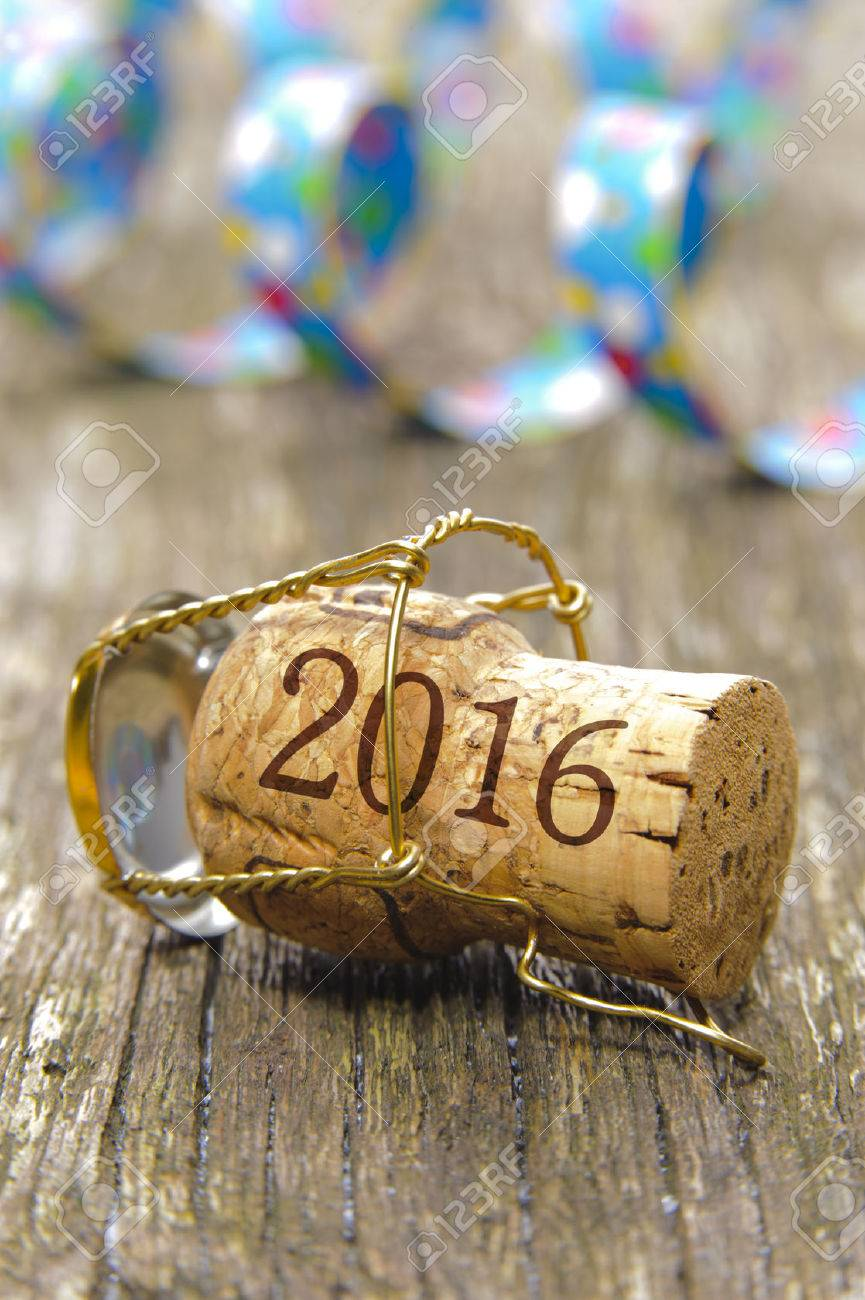 Happy new year 2016 with champagne cork at party - 38027352