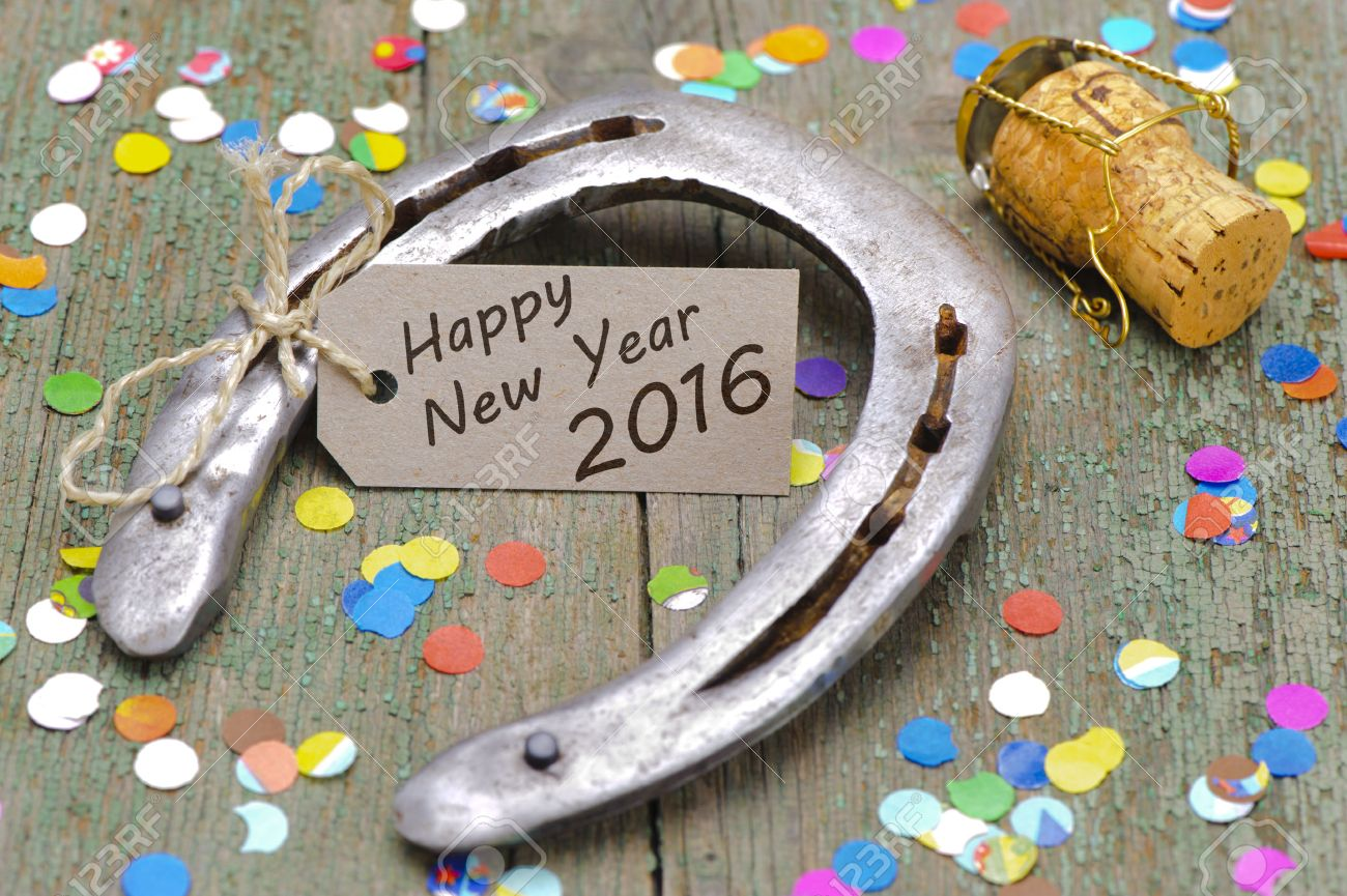 Happy new year 2016 with horse shoe as lucky charm