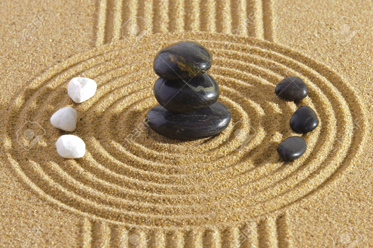 Japanese ZEN garden with Feng shui in sand with stones of yin yang - 38963528
