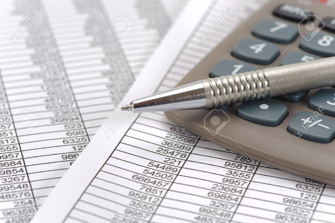 finance and budget calculation with table sheet stock photo picture