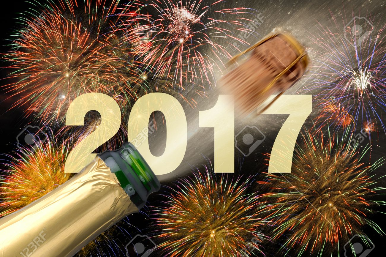 popping champagne and fireworks at new years eve 2017 - 60721056