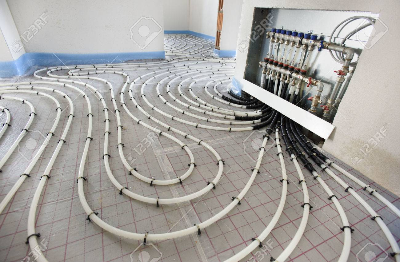underfloor heating in construction of new residential house - 84498958
