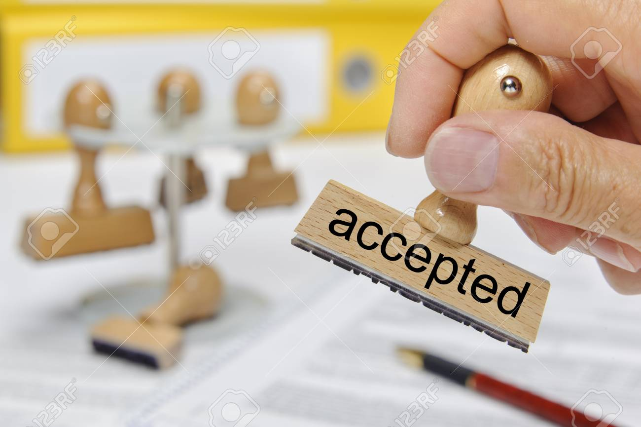 accepted printed on rubber stamp holding in hand - 97760411