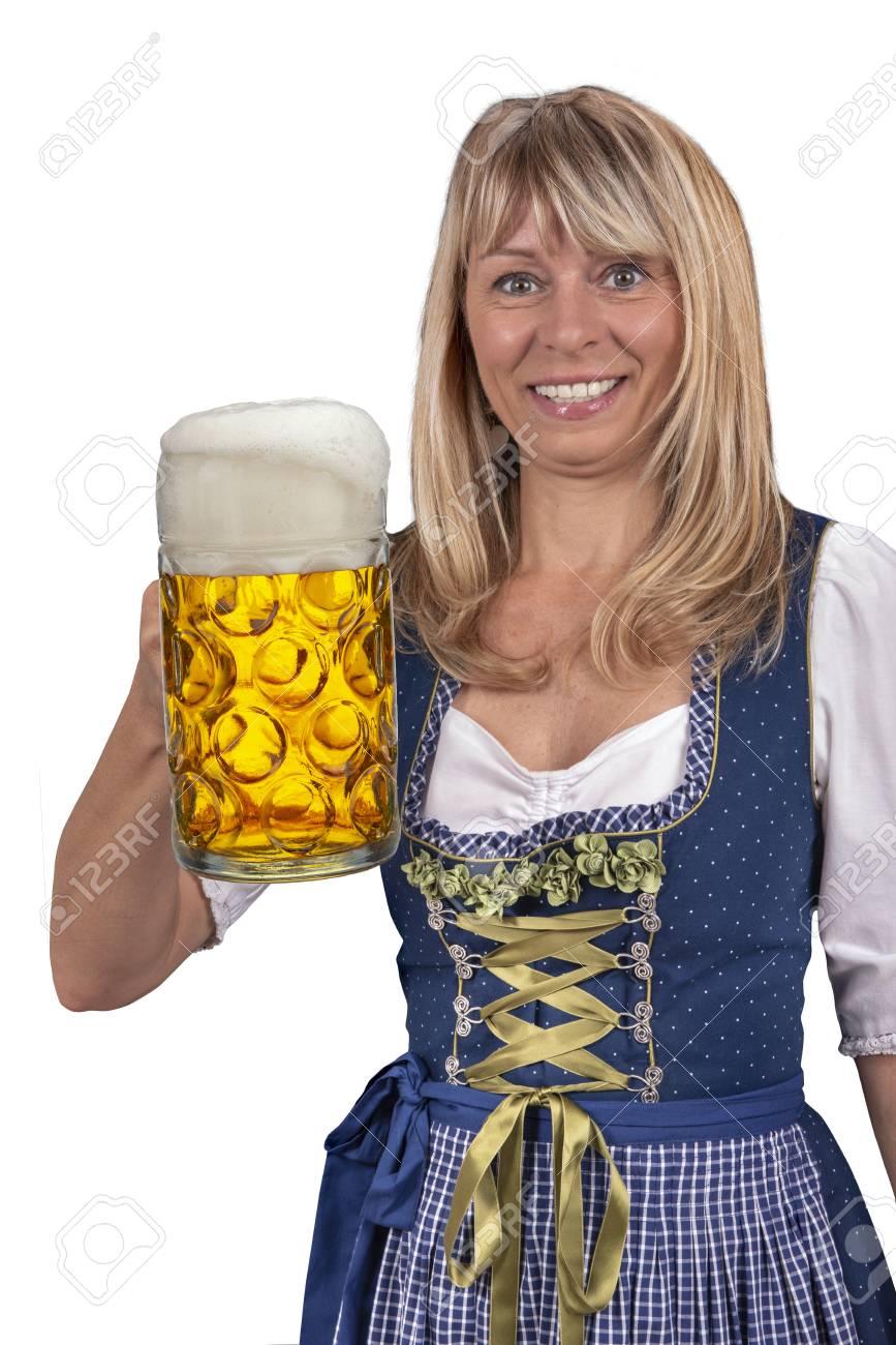 Foto una sostiene en de archivo traje que de munich taza oktoberfest bávaro  en cerveza en Mujer rrqSpg 35bc14670b4e