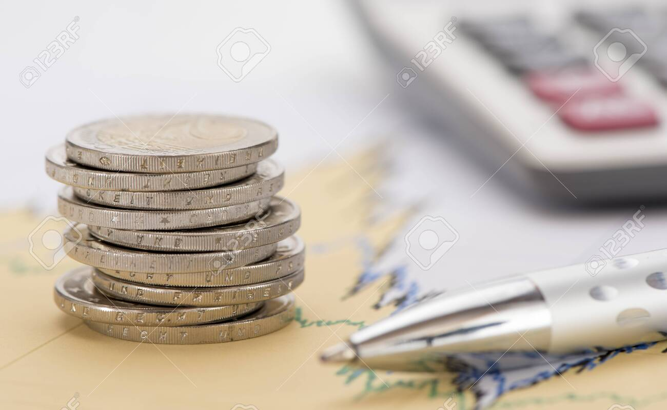 stacked coins of Euro currency - 128296565