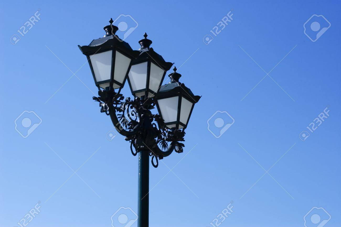 Old street lamp on a blue sky background Stock Photo - 15978612