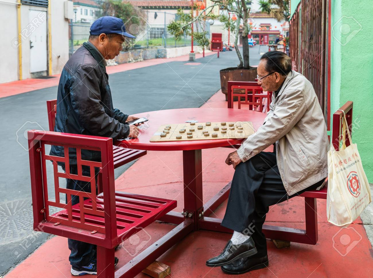 Los Angeles, CA, USA - April 5, 2018: Two senior men play Chinese