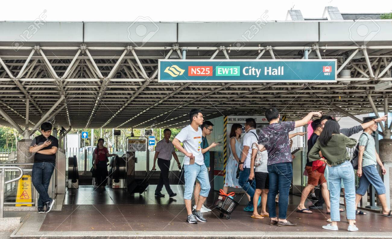 Singapore March 20 2019 City Hall Station In And Exit Of Mrt Mass Rapid Transit System With Plenty Of People Travelers Coming Out And Going In Stock Photo Picture And Royalty