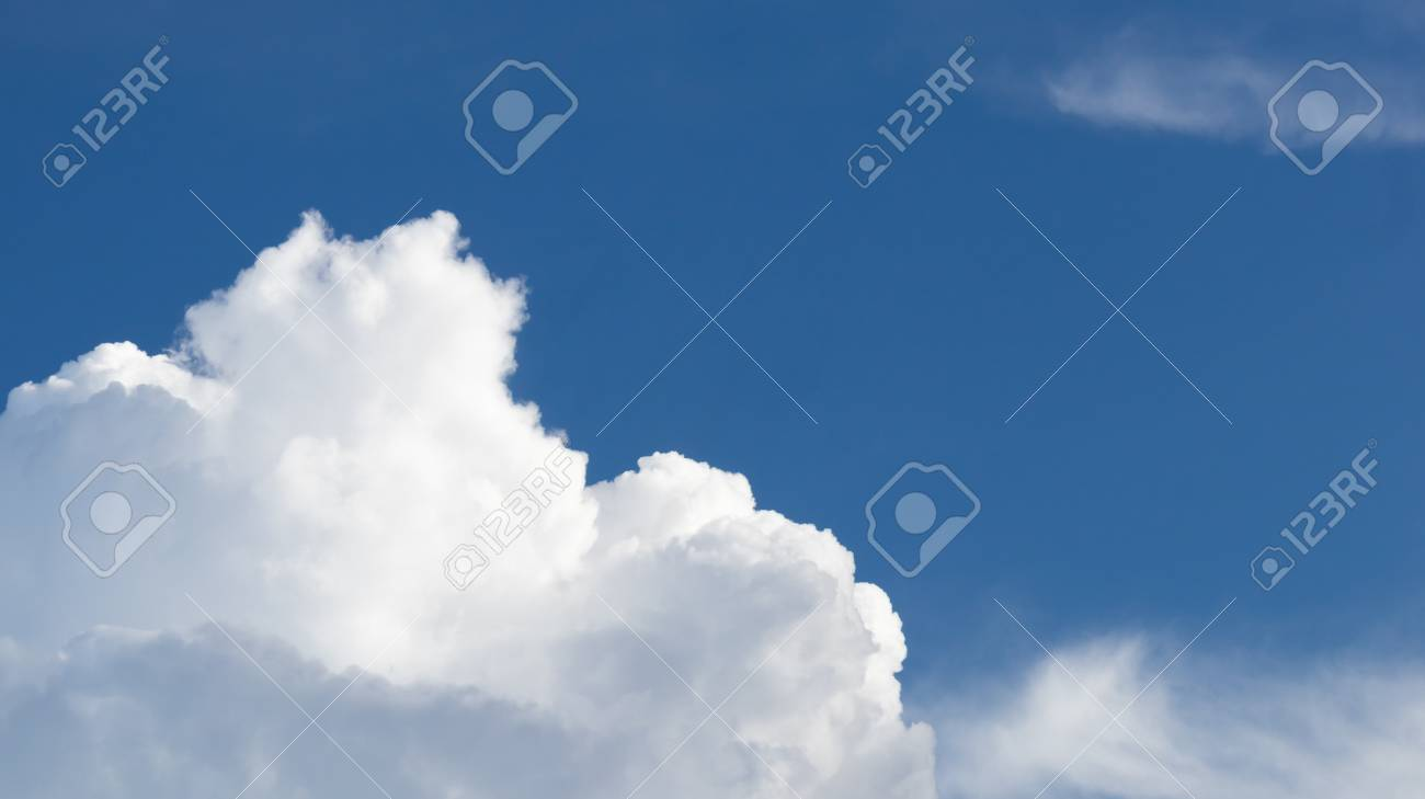 Blue sky with the white cloud in the sunny bright day, a good