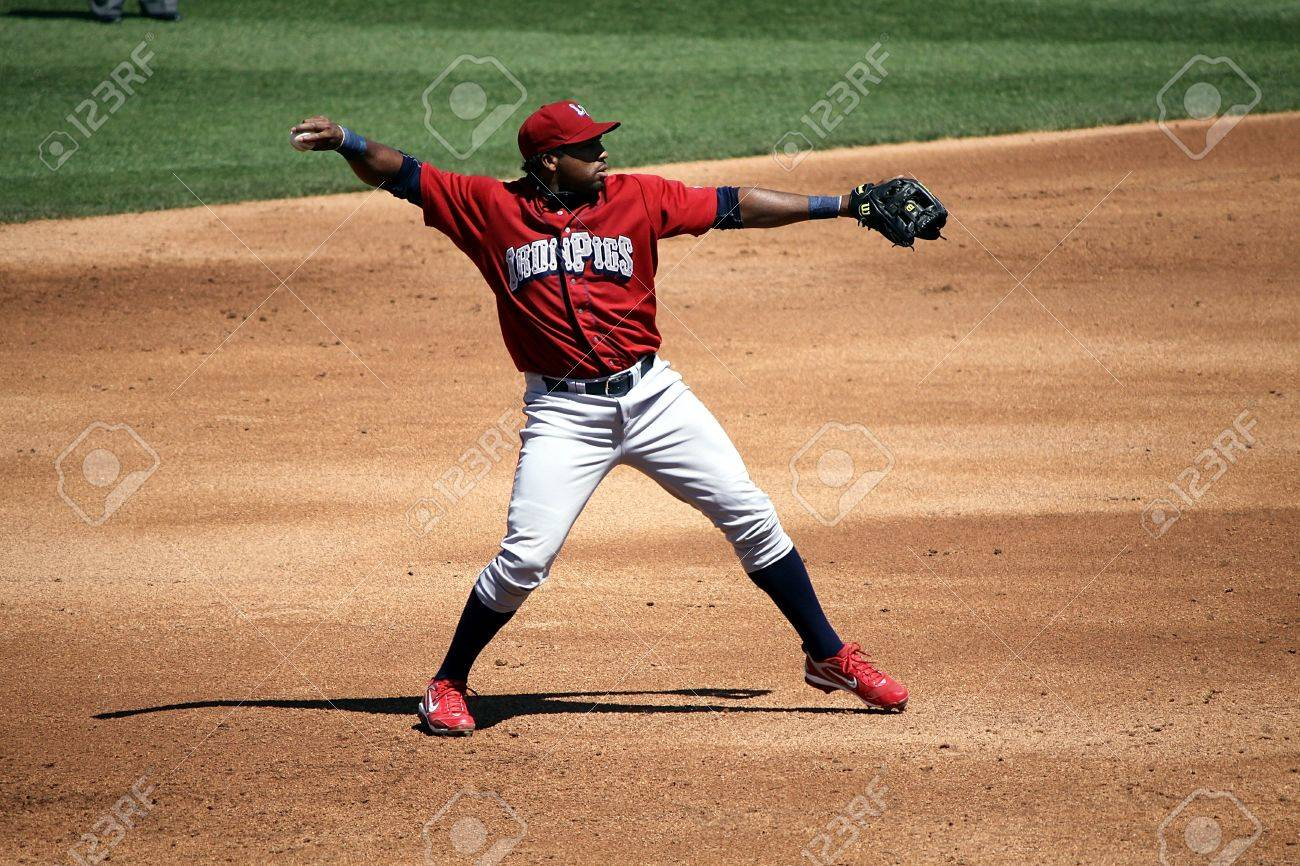 ALLENTOWN, PA - APRIL 29: Lehigh Valley Ironpigs' third baseman Hector Luna makes a throw in a game against Scranton Wilkes Barre Yankees the at Coca-Cola Field on April 29, 2012 in Allentown, PA.  Stock Photo - 13686340