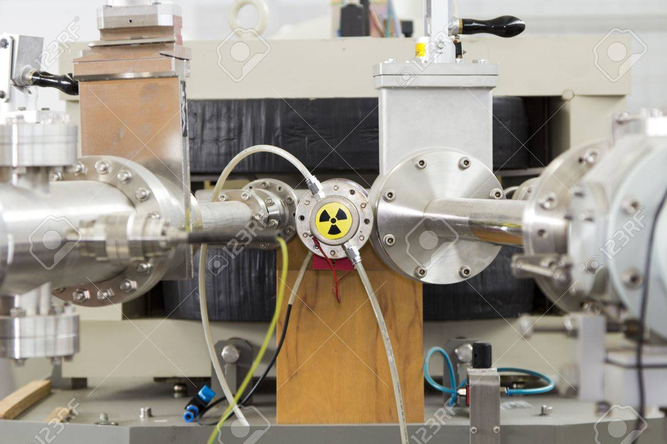 View of important electronic and mechanical parts of ION Accelerator, with high radiation sign, CNC machined parts Stock Photo - 13345601