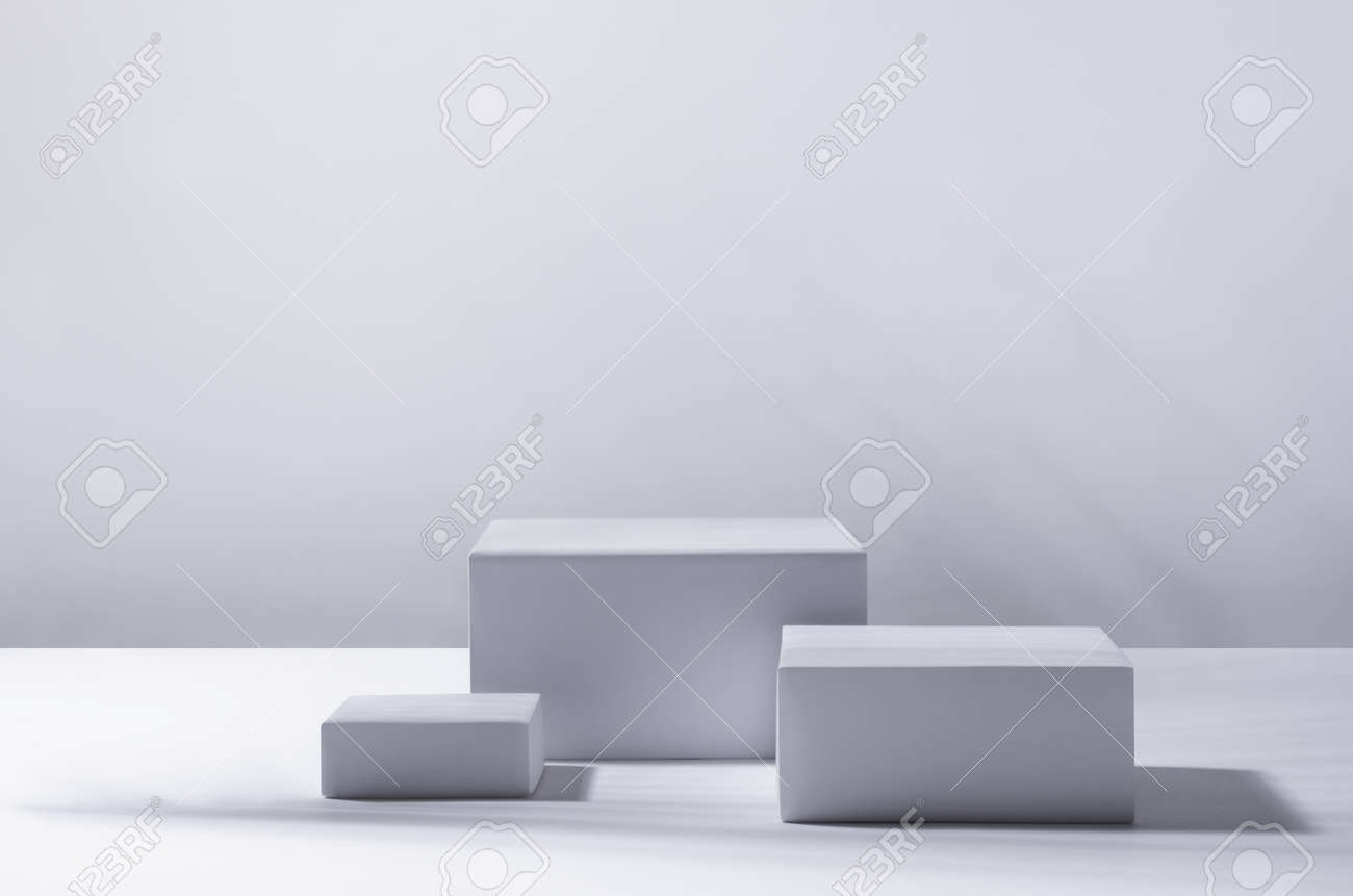 Elegant modern tropical style of showcase for cosmetics product display - white podiums as winner in sunlight with shadow palm foliage in white background. - 168468845