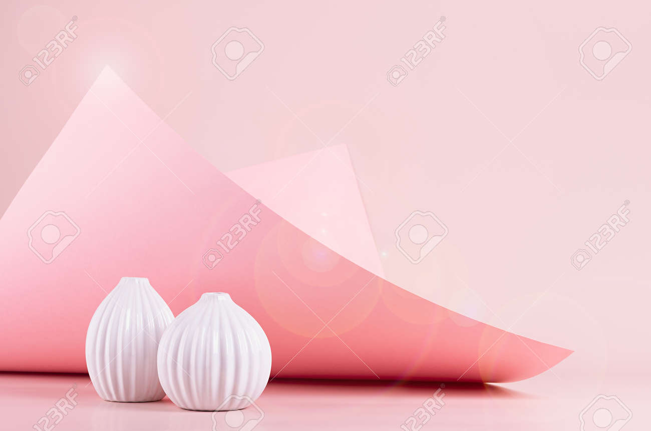 Bright spring fresh pink interior with white ceramic vases in sunlight with flares, hovering bend paper, glowing peak. Elegant geometric background. - 168468850