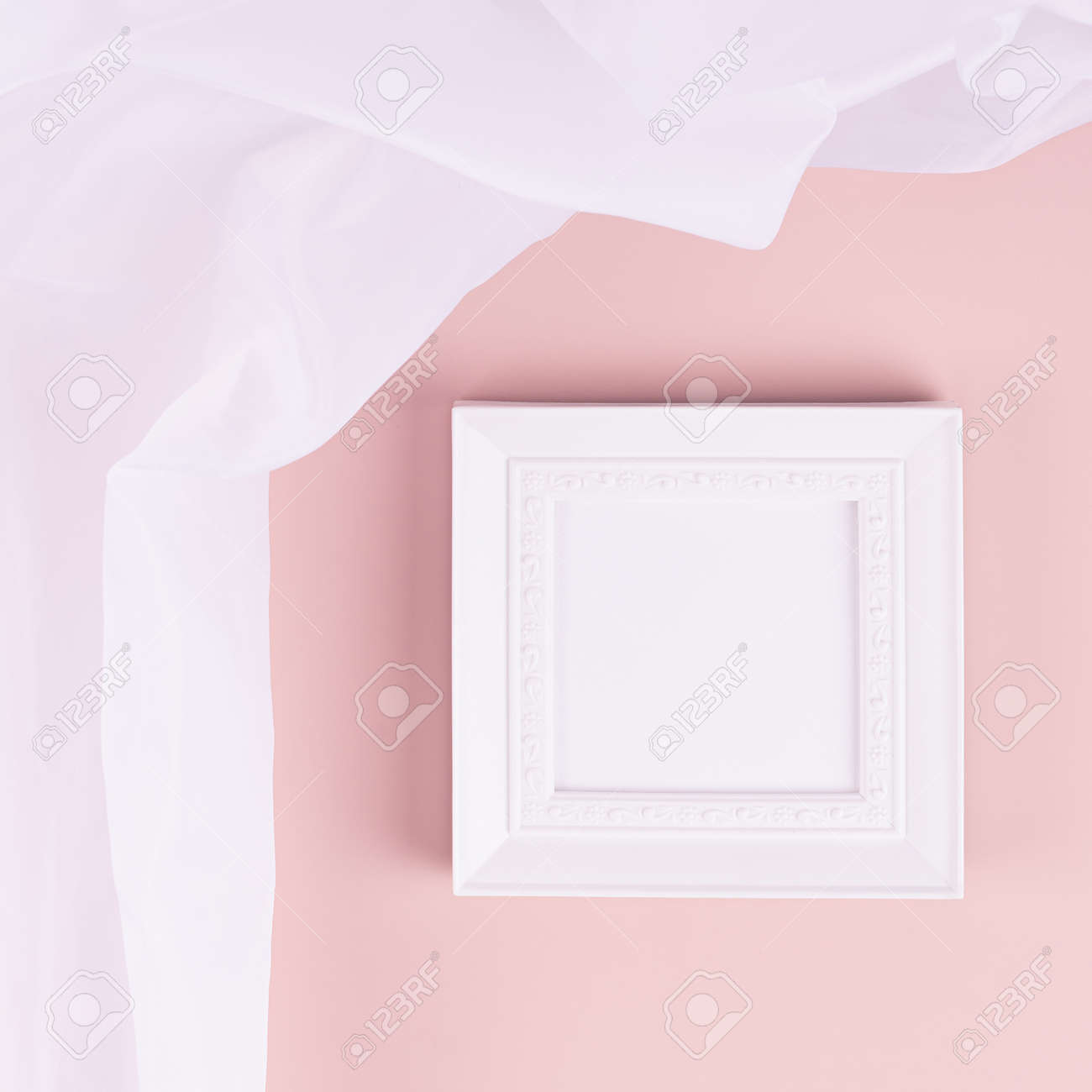 Abstract pastel pink interior with white blank square photo frame for text, design, poster, pictures with flow silk curtain on pastel pink wall. Mock up for display portfolio. - 168468868