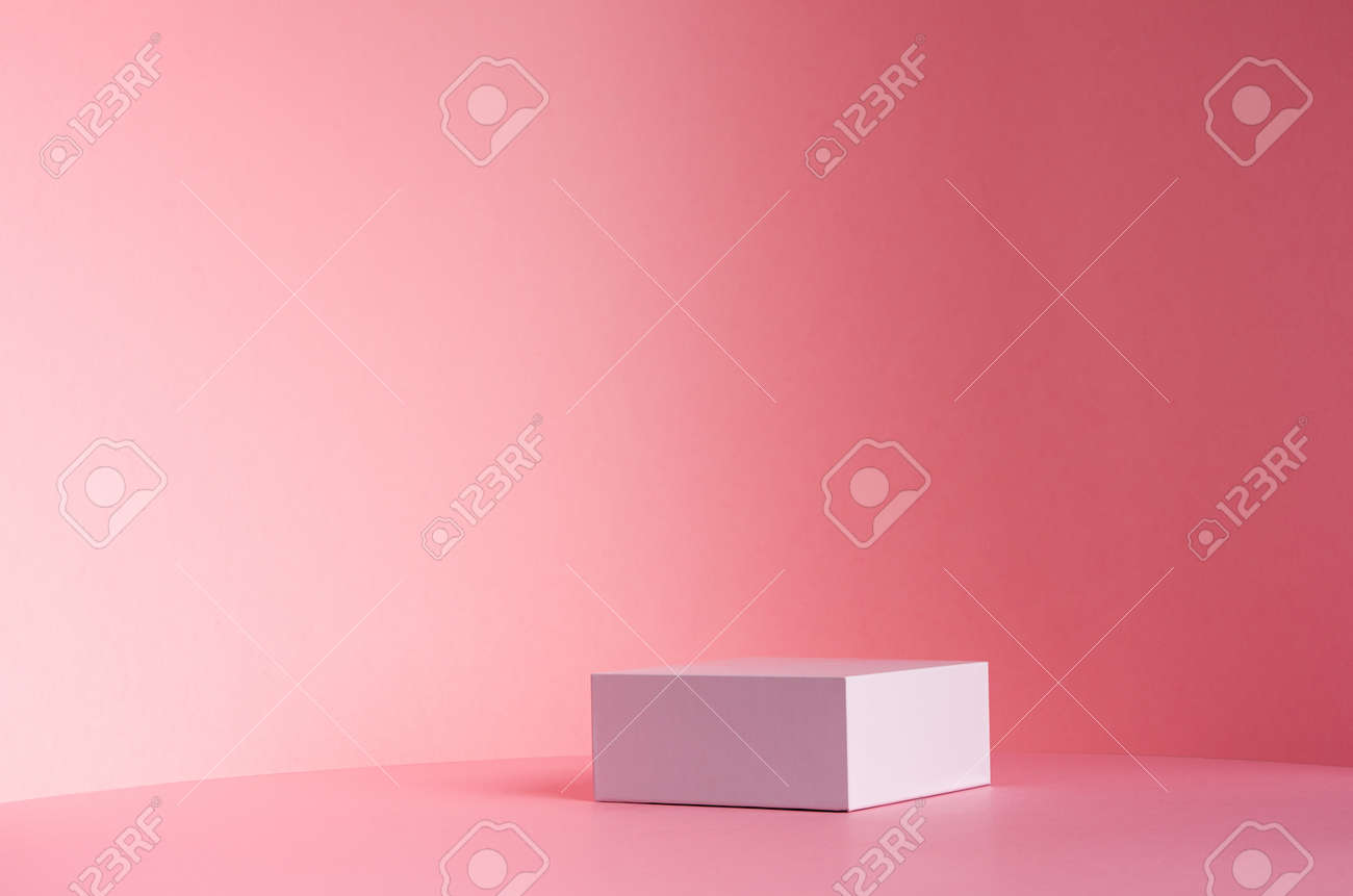 White square podium for display cosmetic and other products in sunlight on gradient pastel pink background, copy space. - 168468869