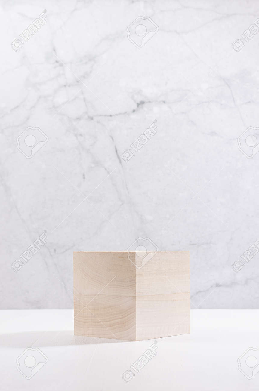 Wooden cube as podium on white wood board and gray plaster wall, showcase for cosmetics product display, vertical. - 168468878