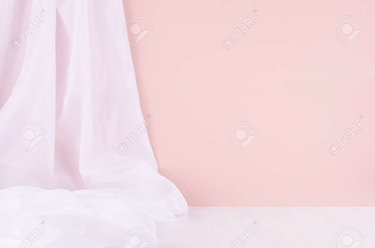 Abstract modern minimal scene or interior with soft light pastel pink wall, white silk curtain and white wood table of floor. Background for display, presentation, showing. - 168468892