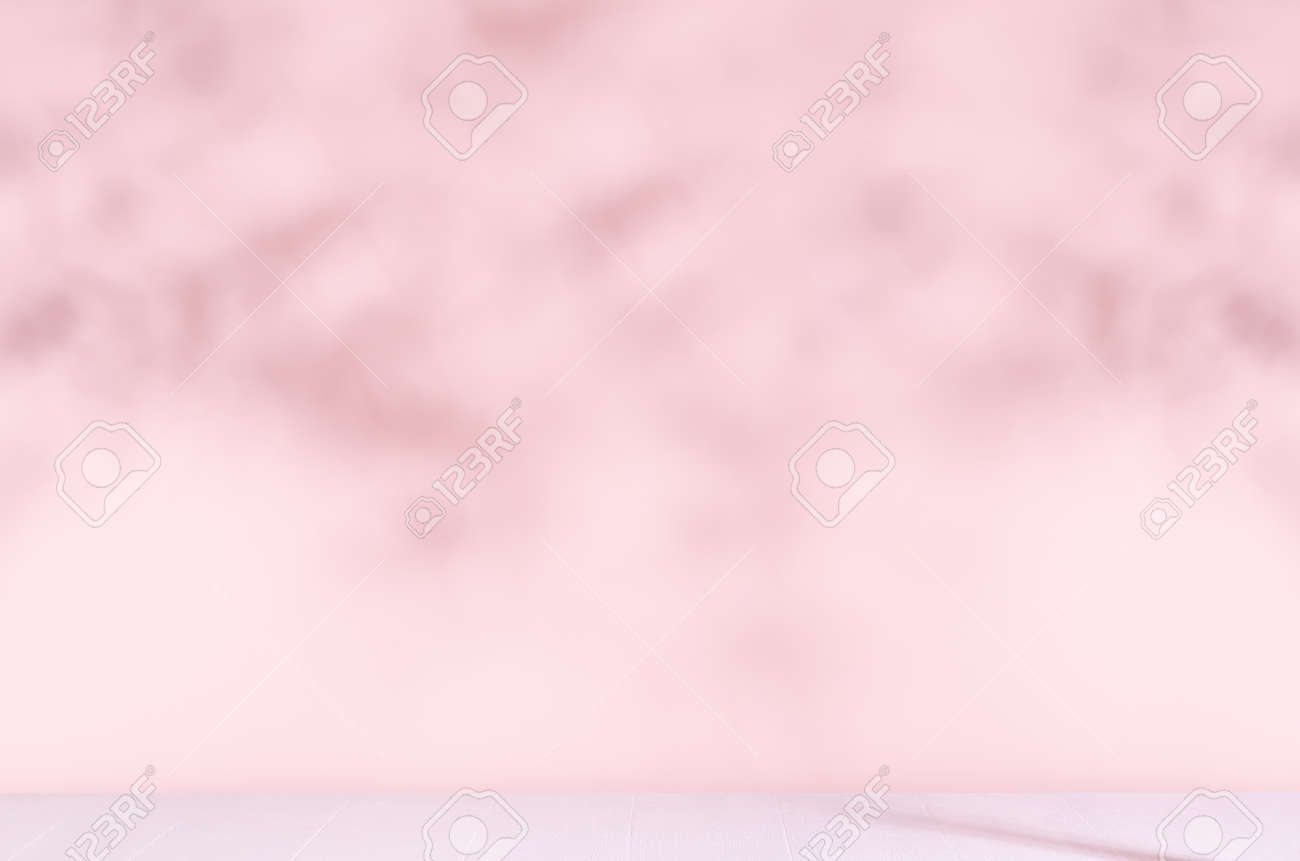 Pastel pink wall with blur shadow of leaves in sunny day with white wood table or floor. Fresh delicate summer background. - 168468894