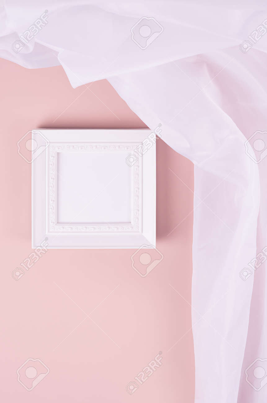 Minimal elegant gallery for display portfolio - blank square photo frame with flow silk curtain hanging on pink wall, vertical. - 168468925