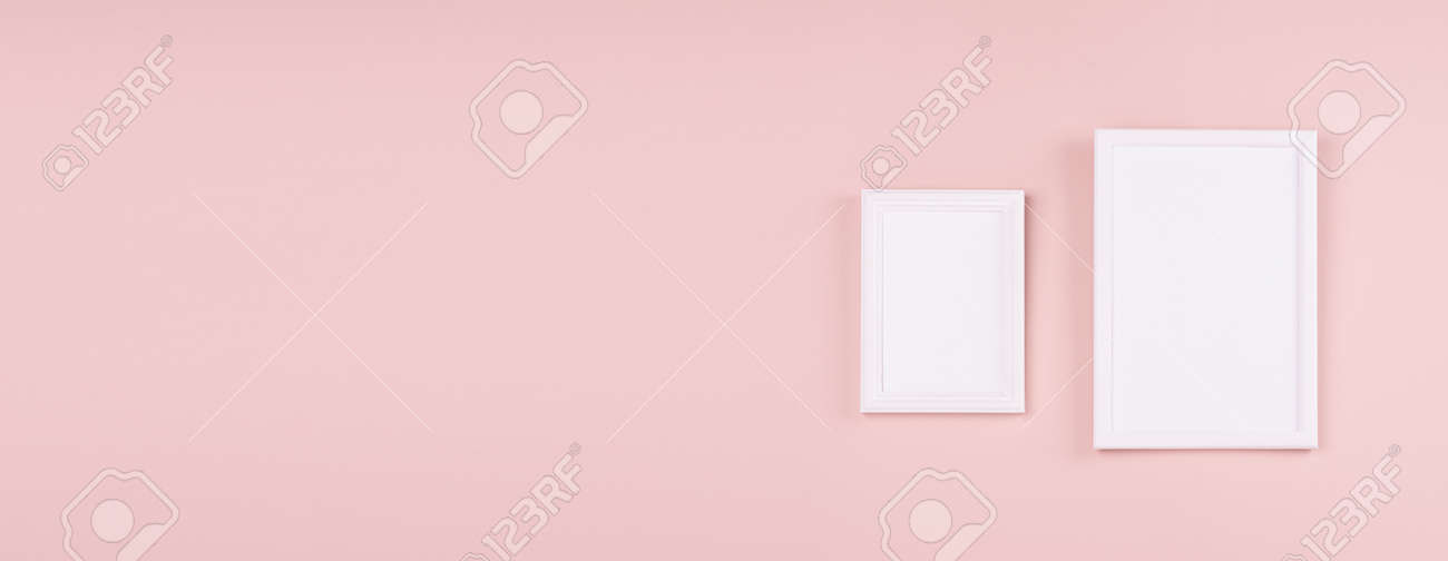 Elegant contemporary gallery in simple style with two black rectangle photo frame hanging on soft light pastel pink wall with copy space, web banner. - 168468966