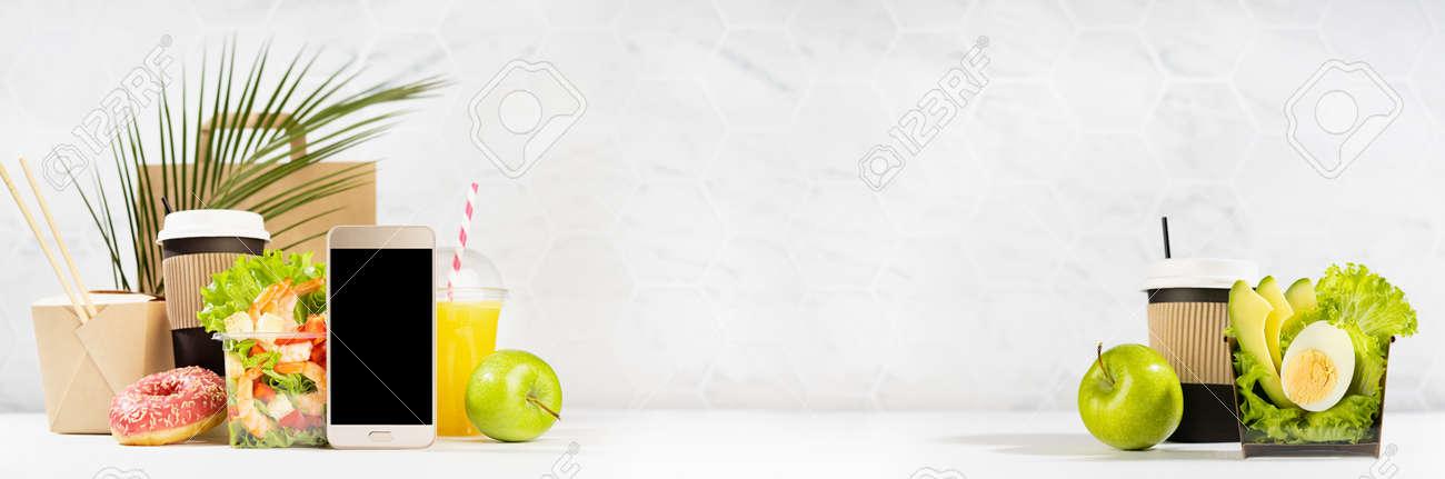 Take away food banner - set of drinks, coffee, salads with shrimp, vegetables, noodles, donut, packet in white interior, palm leaf. Mockup advertising for delivery service, restaurant, online order. - 173913921