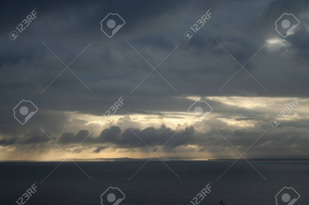 Storm clouds at dawn, Scotland Stock Photo - 374954