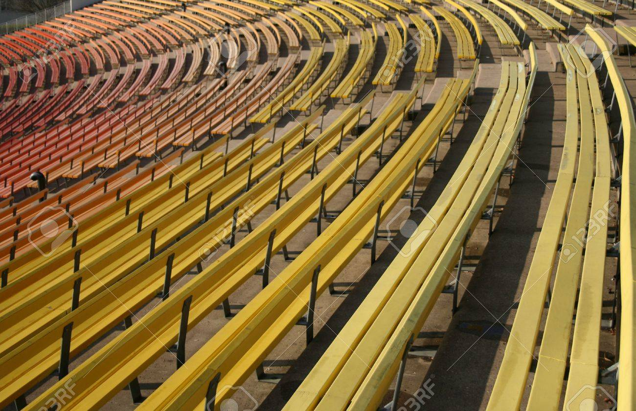 colorful painted benches of stadium seating stock photo, picture
