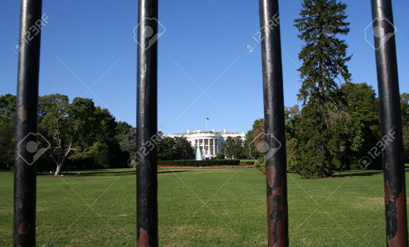 White House framed by bars Washington DC USA Stock Photo - 703621