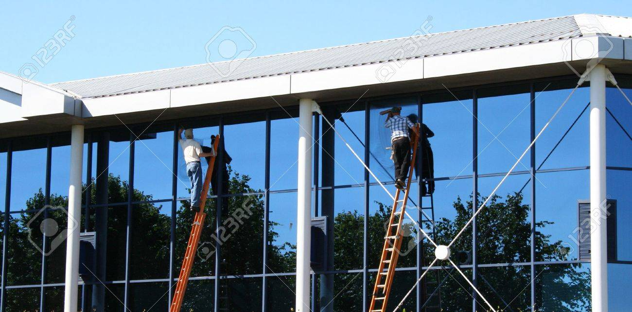 Two window cleaners at work on office building Stock Photo - 753733