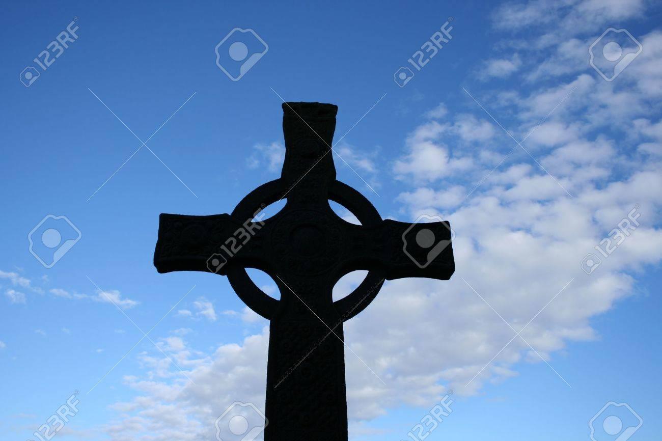 Celtic Cross Silhouetted Against Blue Sky Near Iona Abbey Scotland Stock  Photo   1092116