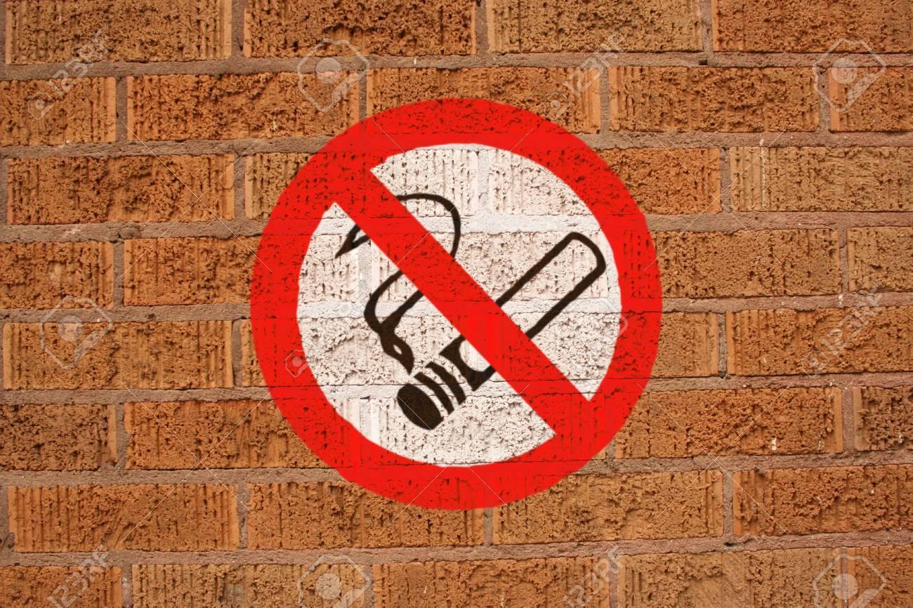 No smoking sign painted on brick wall Stock Photo - 3739734