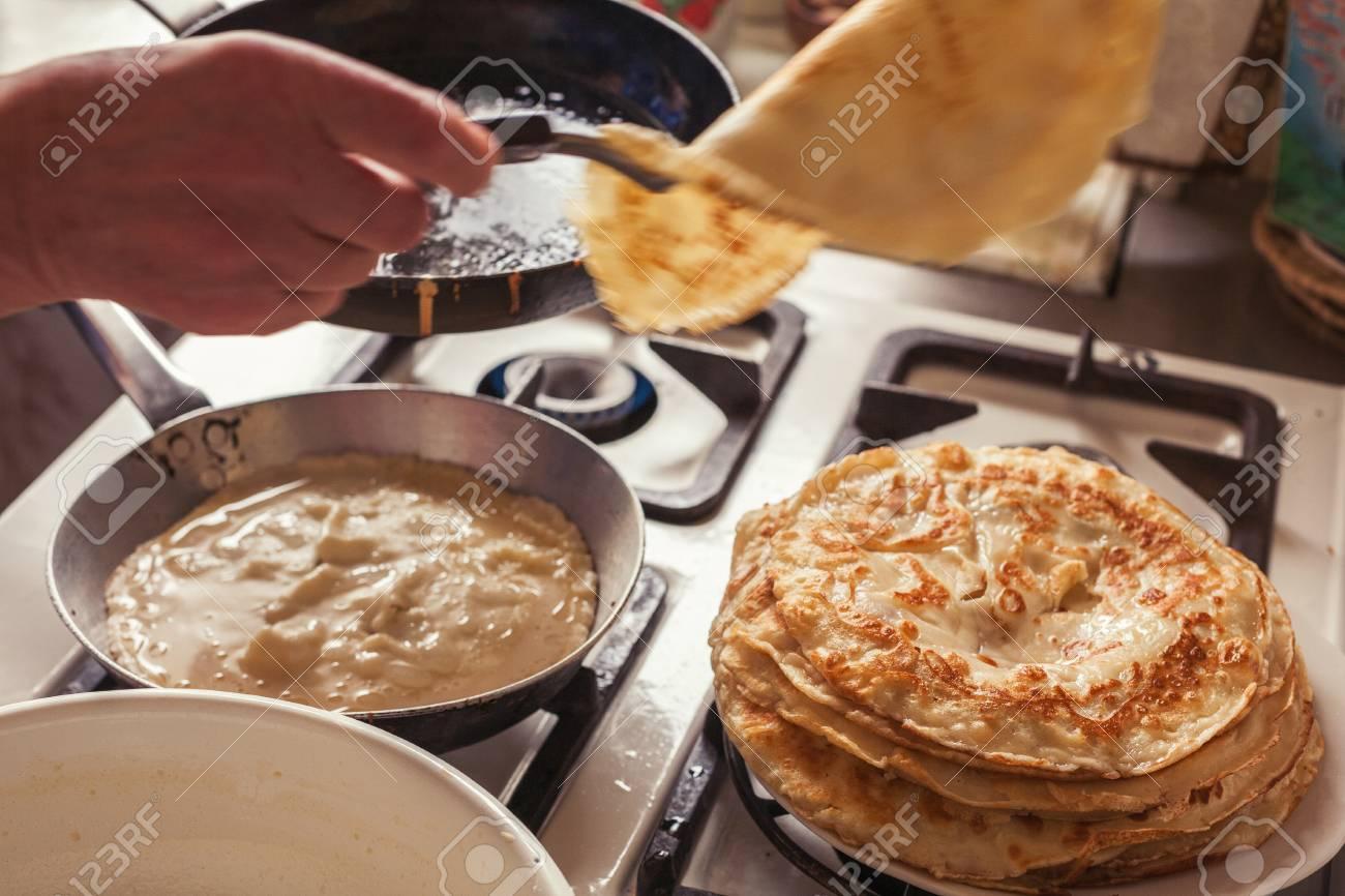 Grandmother making pancakes
