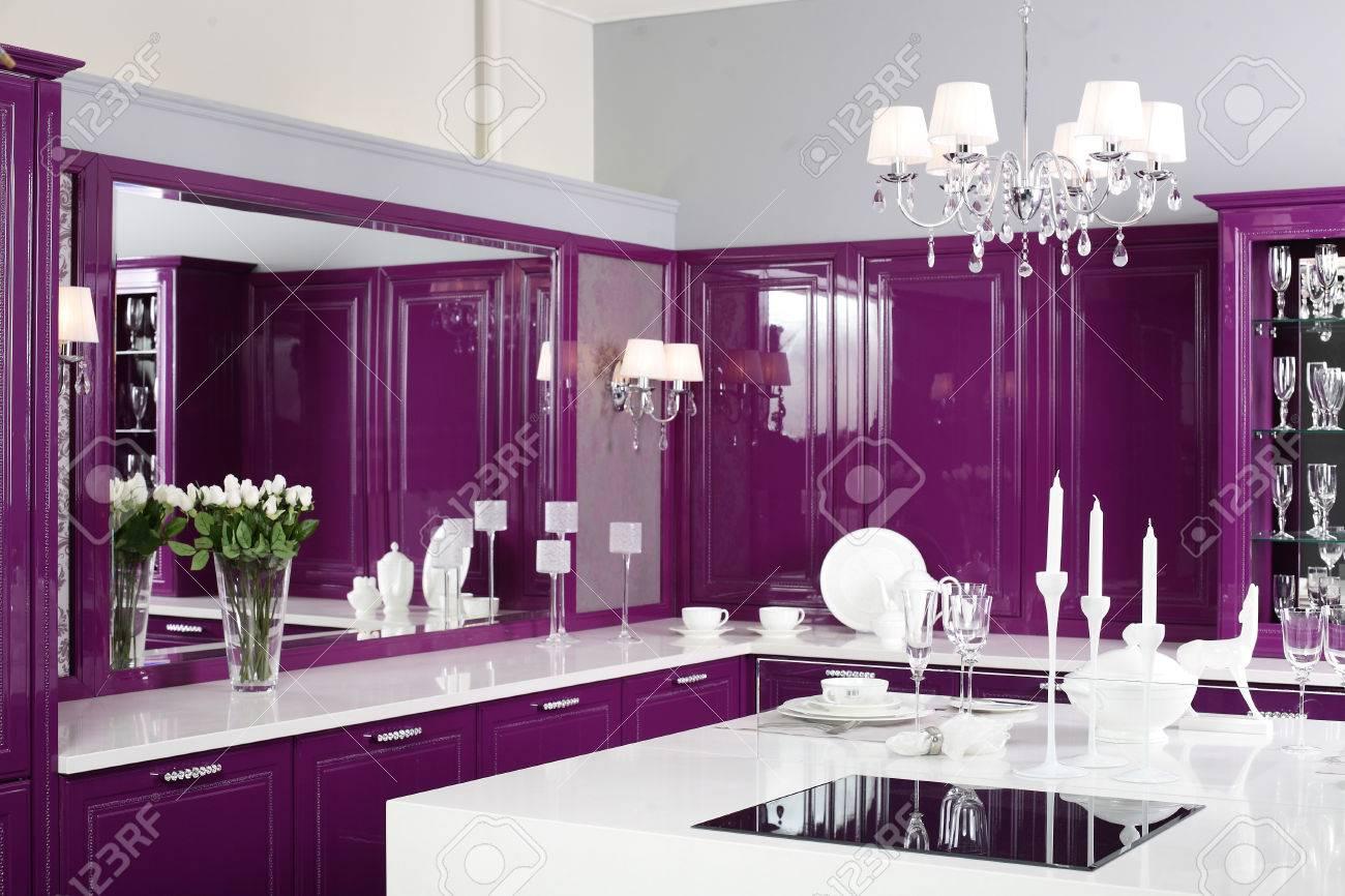 luxury purple kitchen interior with modern furniture stock photo