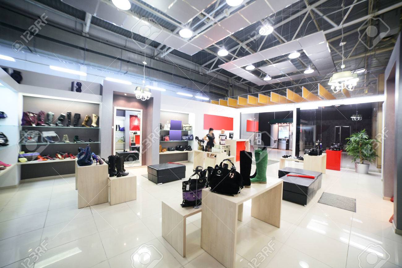 bright and fashionable interior of shoe store in modern mall - 31876897