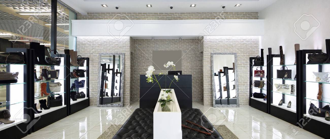 bright and fashionable interior of shoe store in modern mall - 31384045