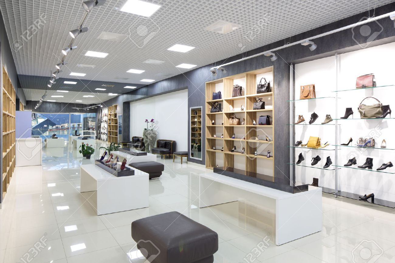 bright and fashionable interior of shoe store in modern mall - 31384049