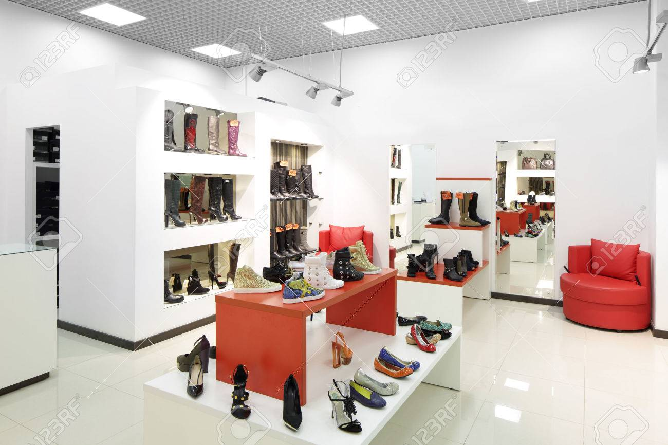 bright and fashionable interior of shoe store in modern mall - 32047512