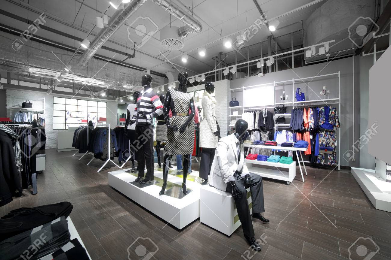 luxury and fashionable brand new interior of cloth store - 32342752