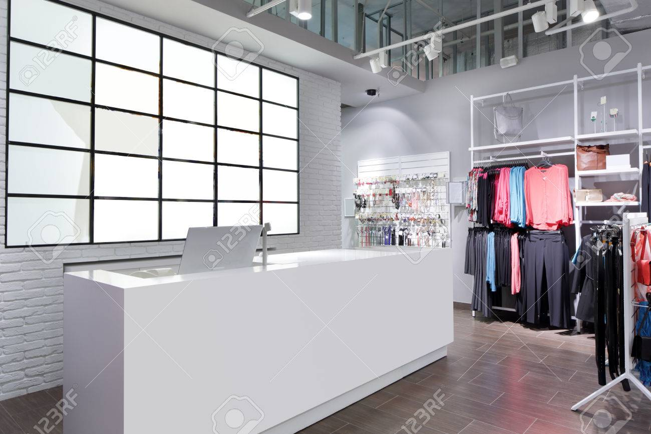 luxury and fashionable brand new interior of cloth store - 32342854