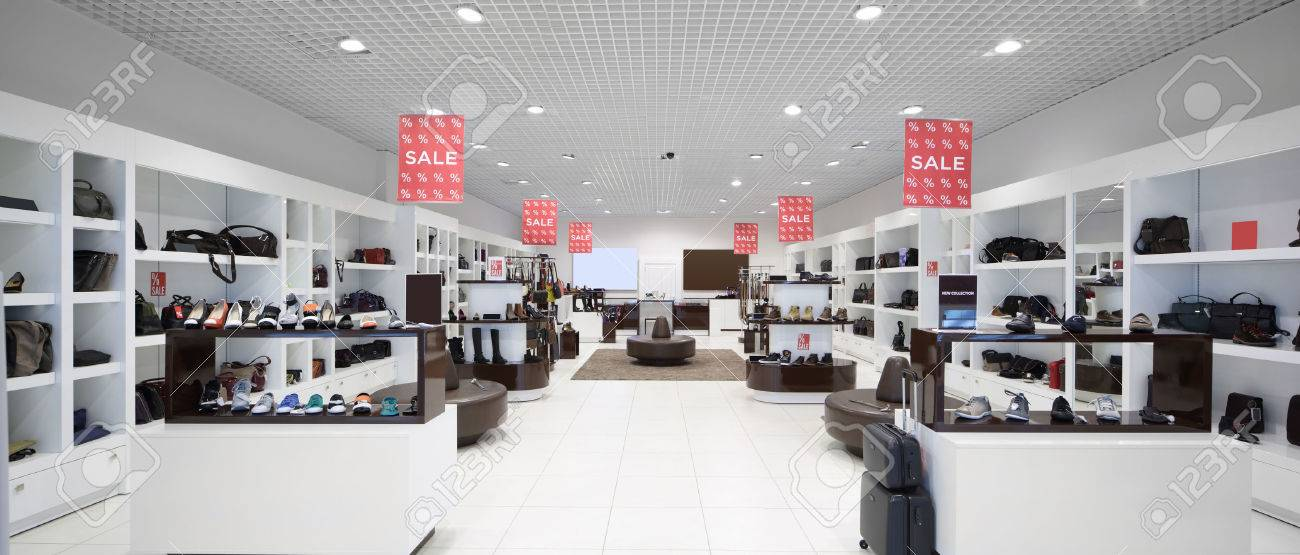 bright and fashionable interior of shoe store in modern mall - 32445950