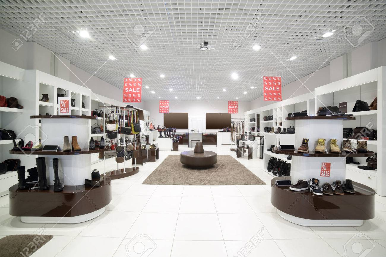 bright and fashionable interior of shoe store in modern mall - 32432309
