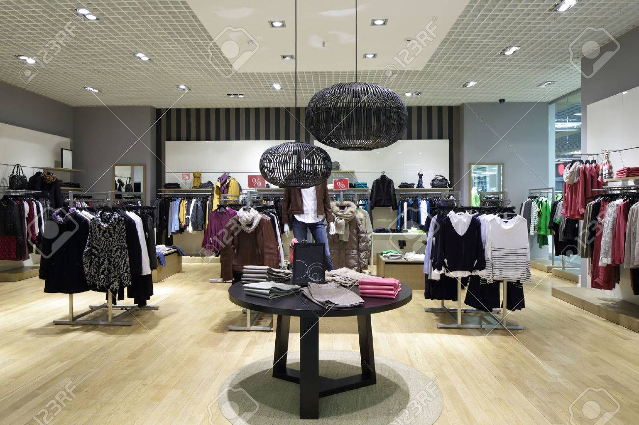 luxury and fashionable brand new interior of cloth store - 32342929